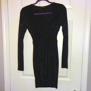 Long sleeved bodycon dress with plunging neckline